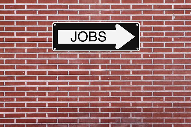 Muro com uma placa escrito Jobs